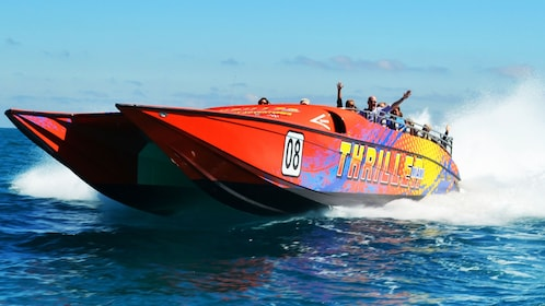 Close-up of red Thriller speedboat cutting through the water of Miami