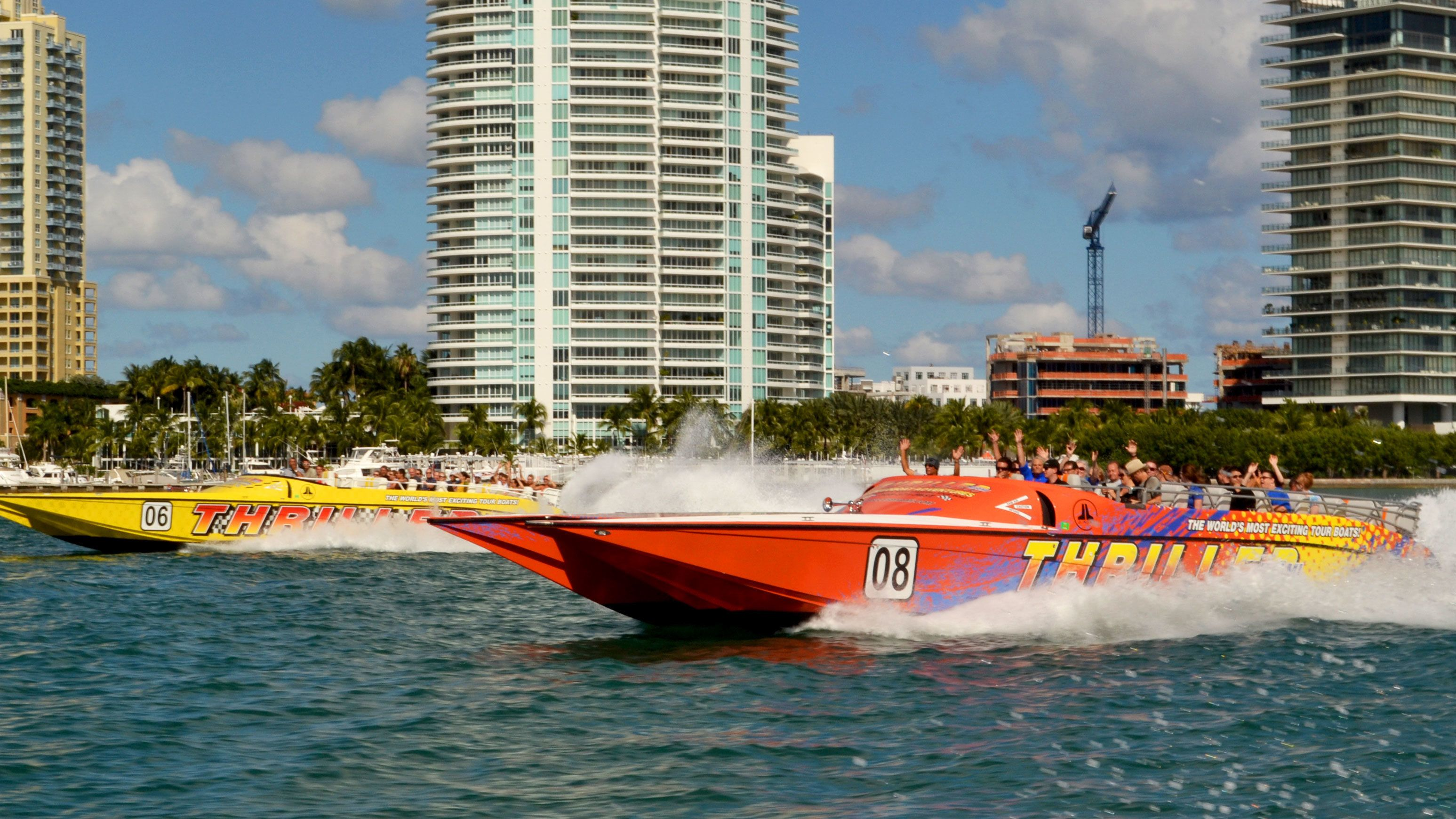 Two Thriller speedboats race through the waters off Miami
