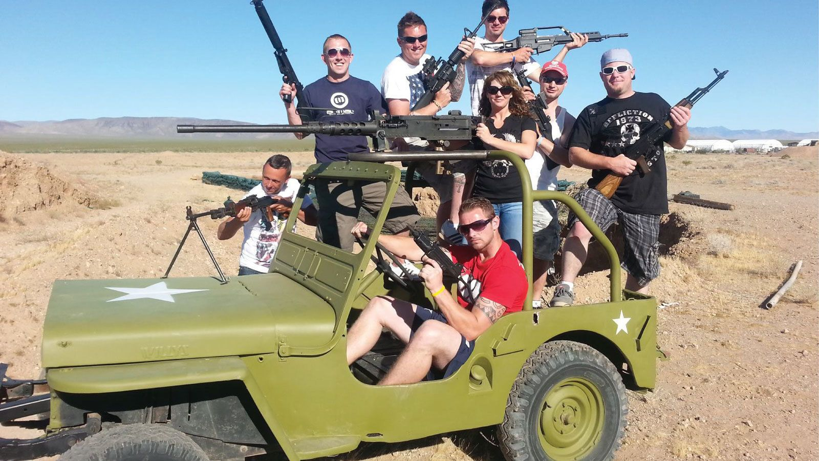 an armed group crowding on a small jeep vehicle in Las Vegas