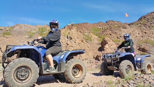 riding ATVs through the dry desert in Las Vegas