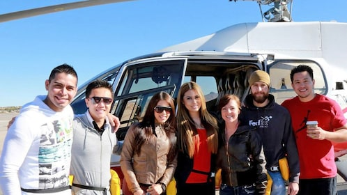 group standing in front of a grounded helicopter in Las Vegas
