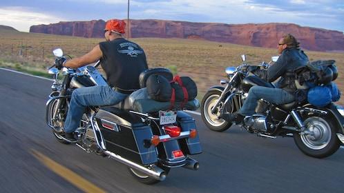 men riding Harley Davidson motorcycles through the desert roads in Las Vegas