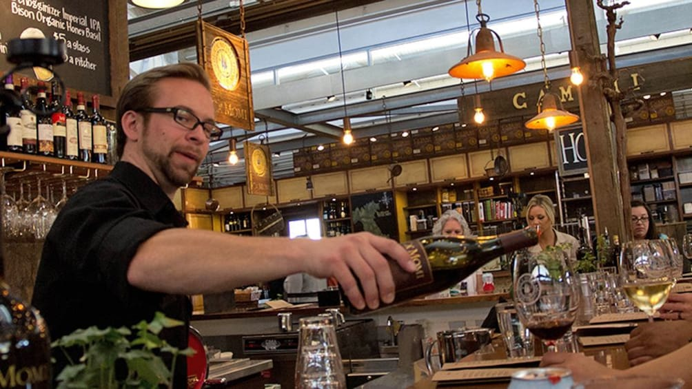 Man pouring wine in california