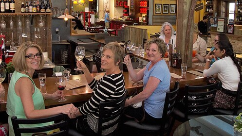 Ladies drinking wine at a bar in California