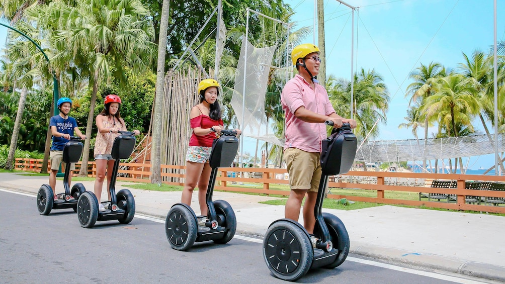 Show item 3 of 5. Family on Sentosa Segway Tour in Singapore on a sunny day