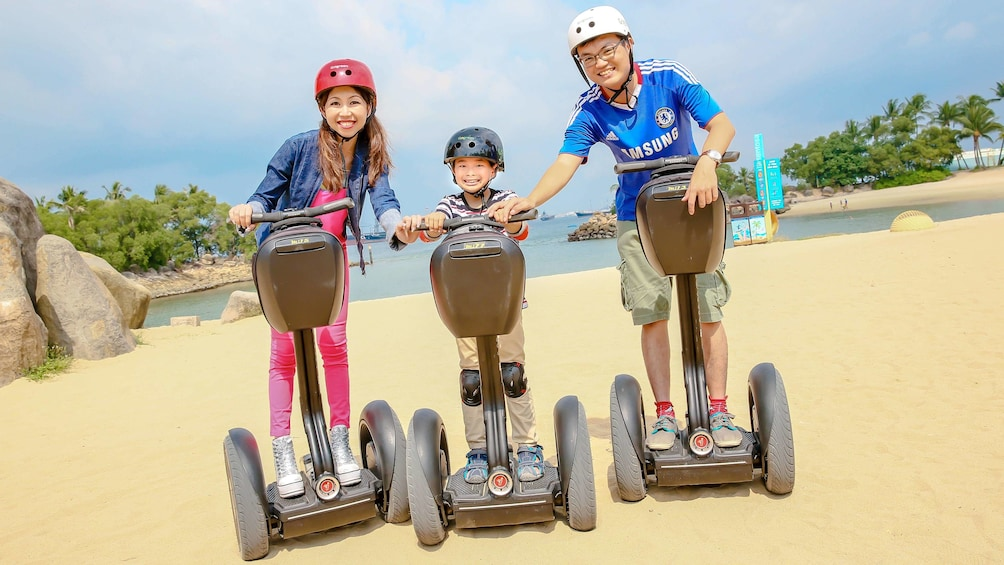 Show item 4 of 5. Family on a scenic segway tour of Singapore