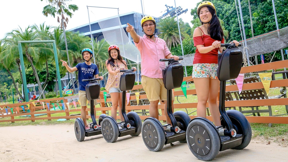 Show item 2 of 5. Family enjoying the Sentosa Segway Tour in Singapore
