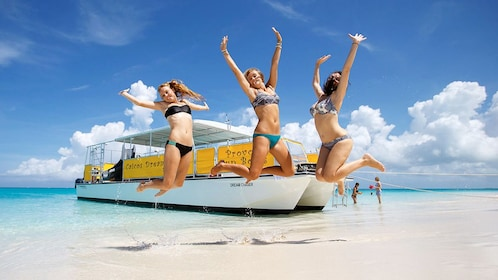 Three ladies jumping on the beach on the Turks and Caicos