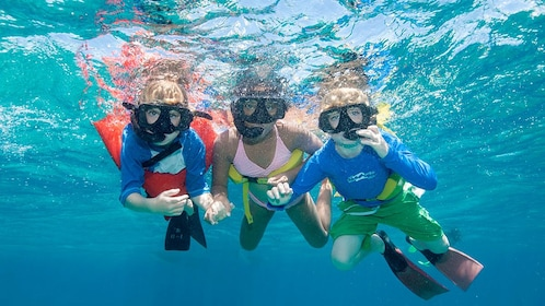 Three snorkelers in the Turks and Caicos