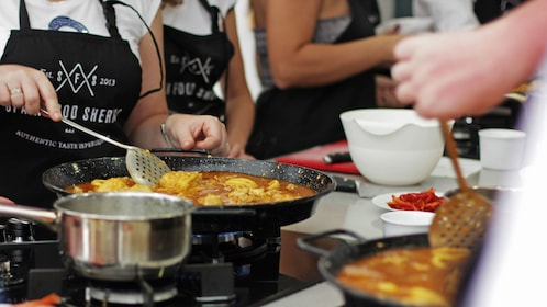 Guests learning at the Spanish Paella-Cooking Workshop in Malaga