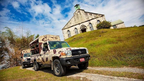 tour truck on the trail from historic landmark in jamaica
