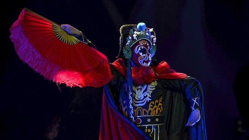 Performer on stage performing at the Sichuan Opera in Chengdu