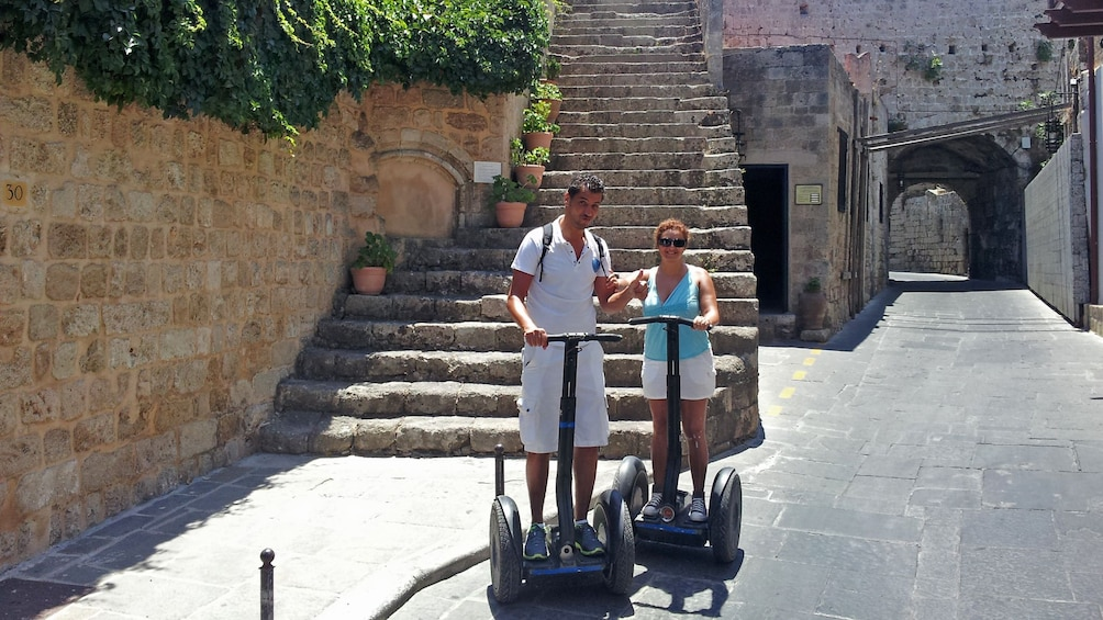 Show item 2 of 4. segway riders at base of stone staircase