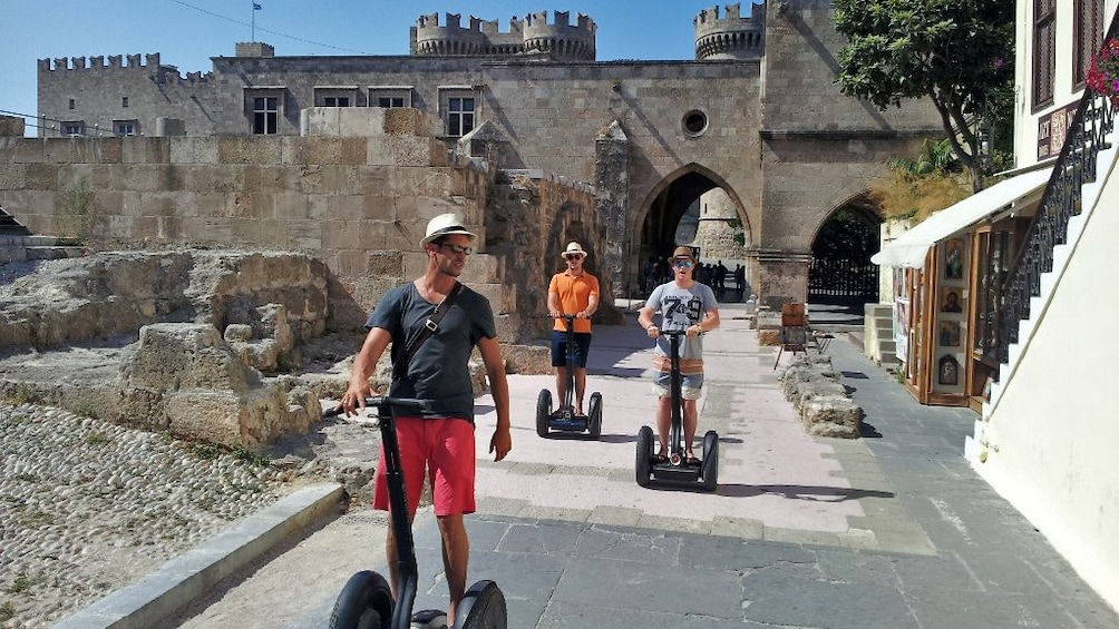 Show item 1 of 4. segway riders near landmark in Rhodes