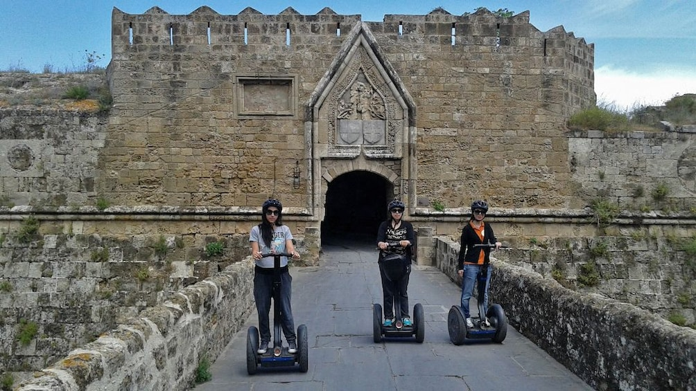 Show item 3 of 4. segway riders at castle in rhodes