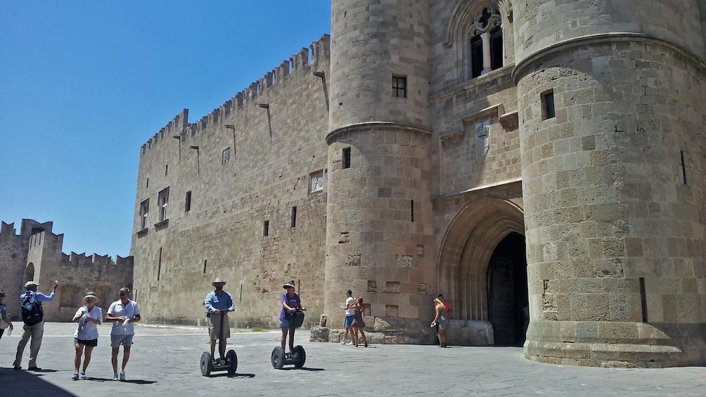 Show item 3 of 5. segway riders near landmark in Rhodes