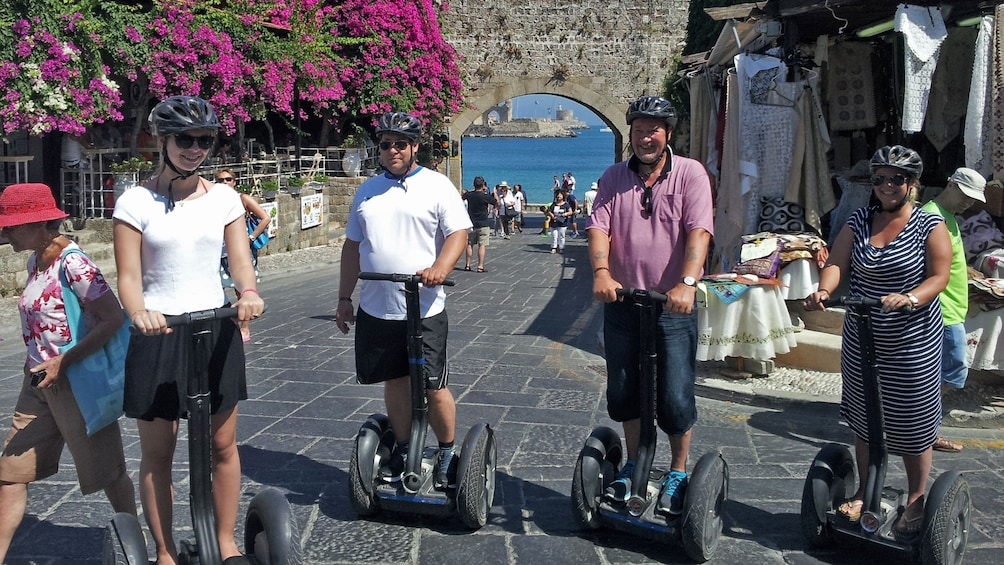 Show item 1 of 5. segway riders in town street in rhodes