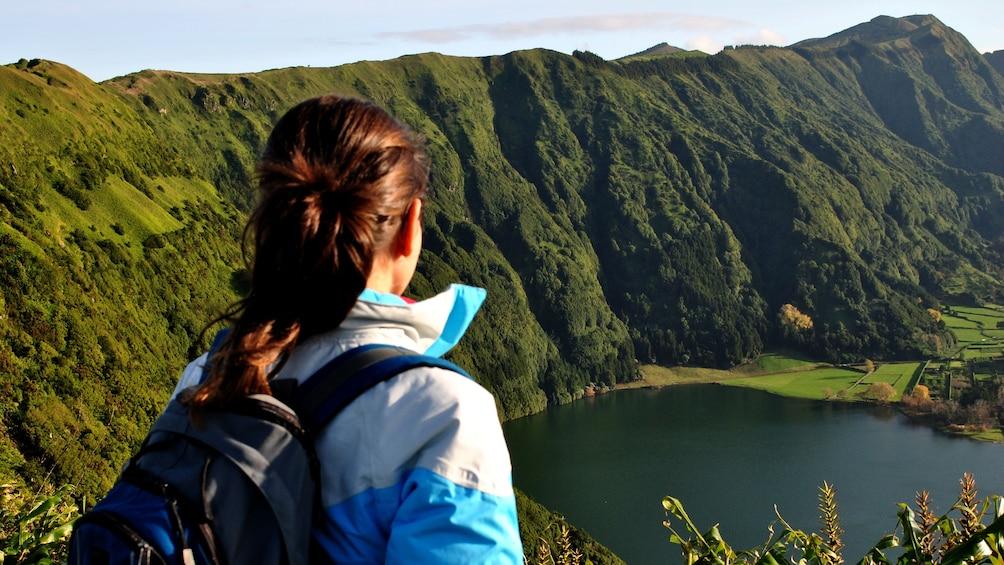 Woman looks down at lake during Sete Cidades Half-Day Safari