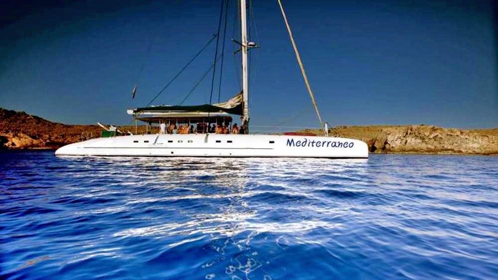 A catamaran on blue waters