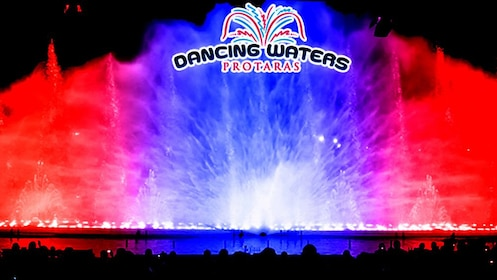 Red and blue lights light up fountains in Dancing Waters Show