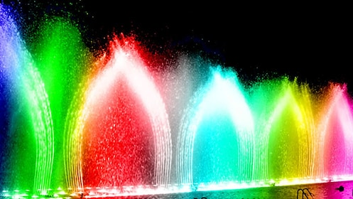Yellow, Green, Red and blue lights light up fountains in Dancing Waters Show