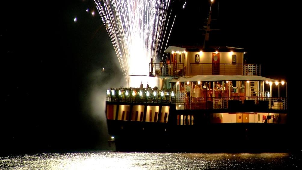Show item 1 of 7. Fireworks explode off the deck of WaveDancer