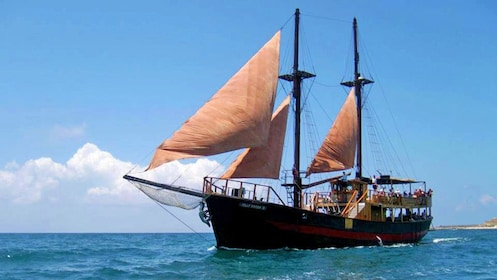 A pirate cruise sets sail on blue waters