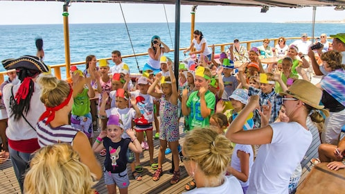 Children play along on the deck of a Pirate cruise