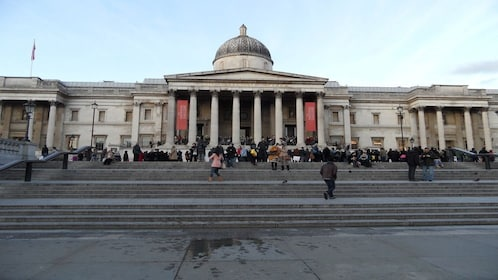 large crowds gathered at the steps of the National Gallery in London