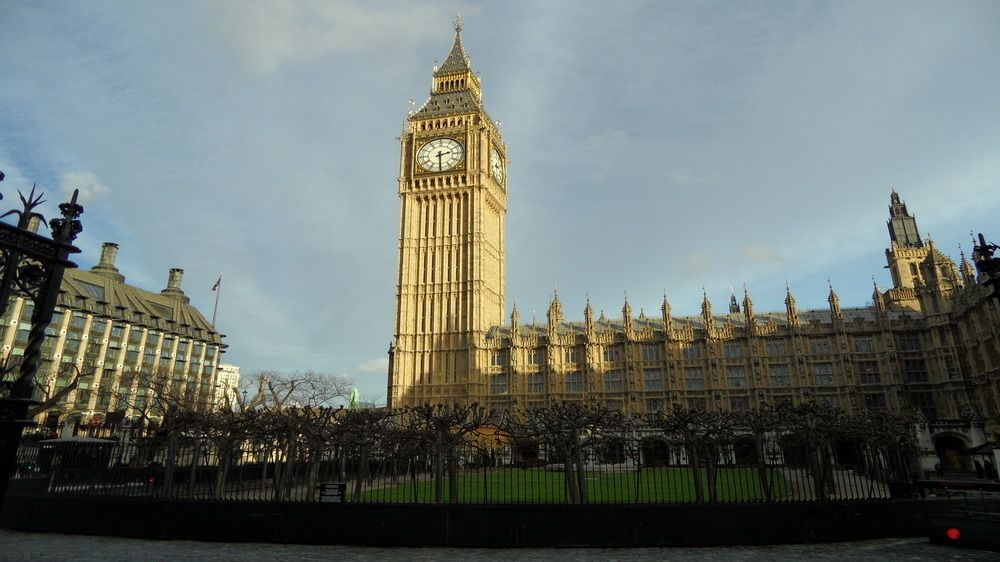 the tall clock tower at the House of Parliament in London