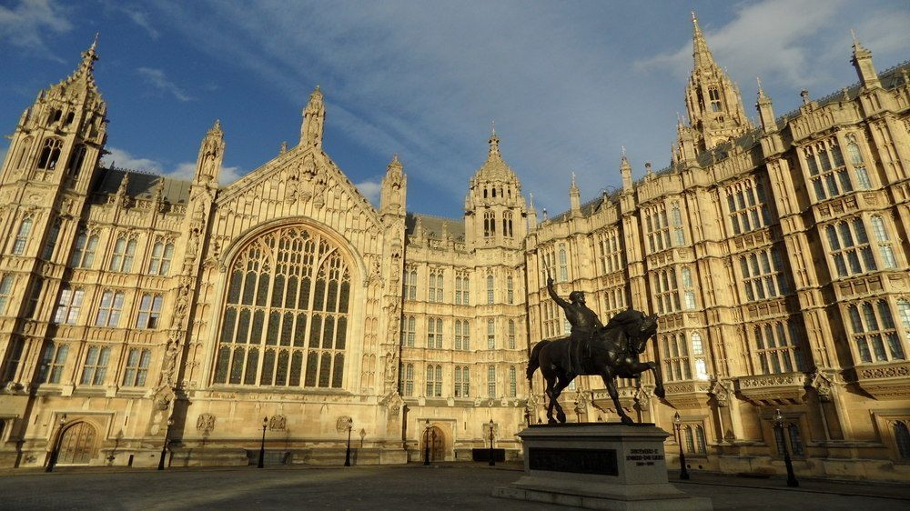 statue outside of the Houses of Parliament in London