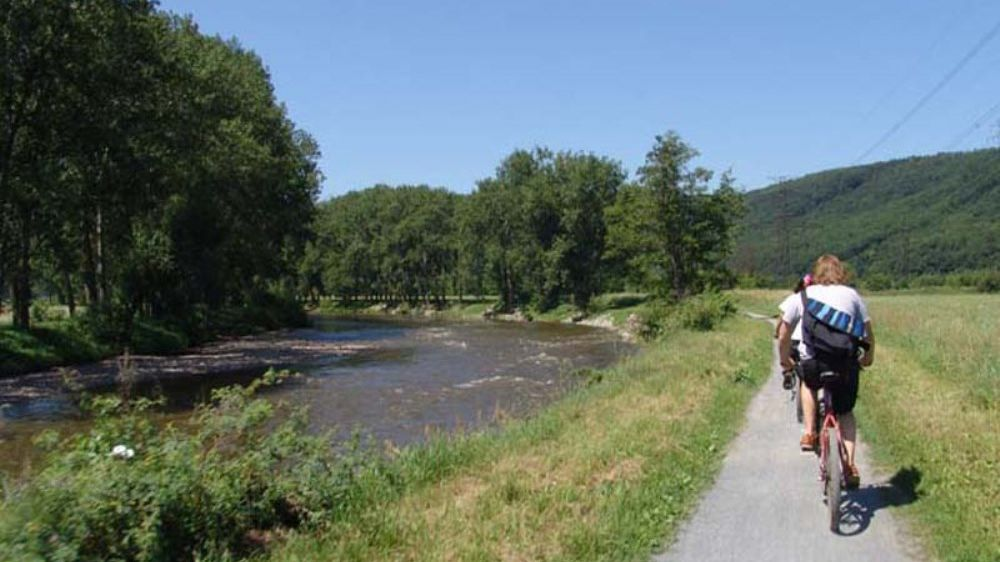 riding bikes along river