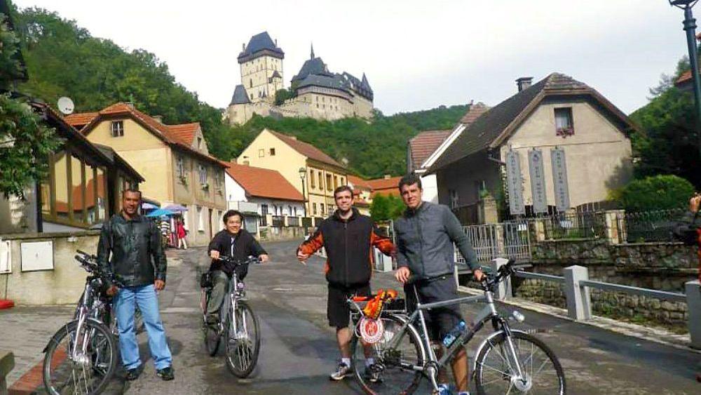 A group of bike riders below Karlstejn castle