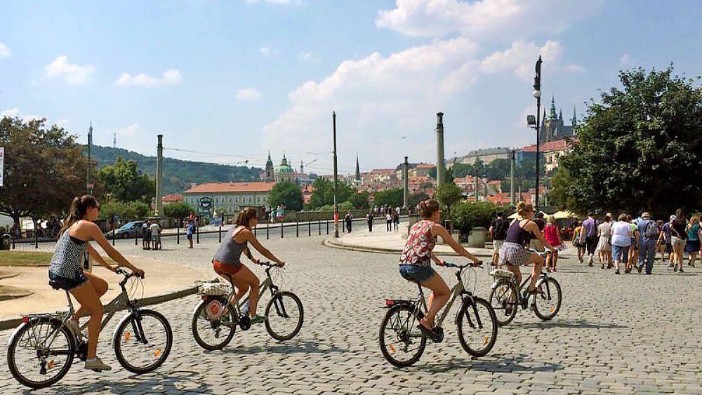 A bike tour of Prague on a cobblestone street.