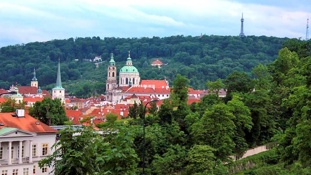 The wooded hills and old buildings of Prague