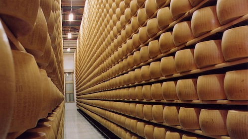 Racks of wheels of Parmesan cheese being aged