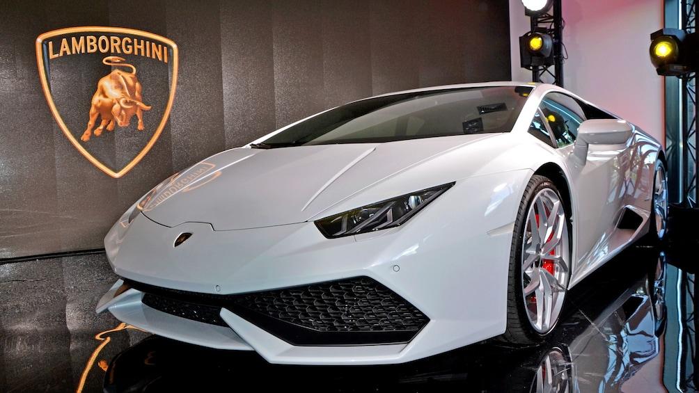 Show item 1 of 5. A white Lamborghini in a museum.
