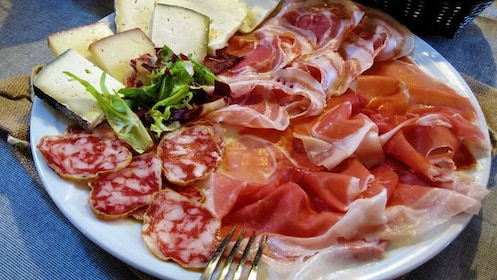 A plate of meat and cheese