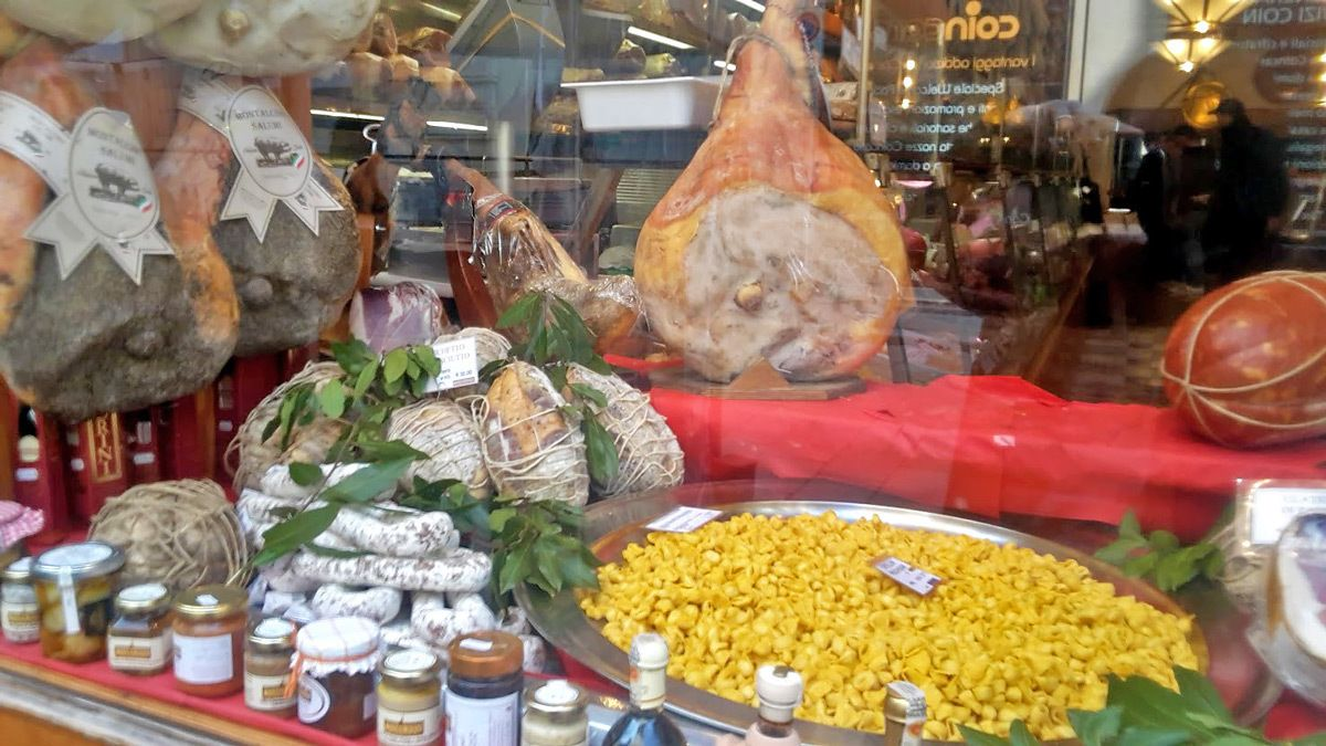 Smoked Ham, Ravioli, cheese, and spices in a storefront window