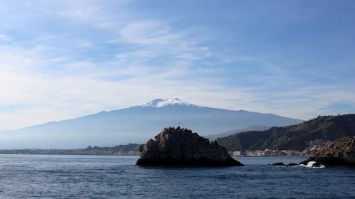 Mountain and island during Taormina Boat Tour