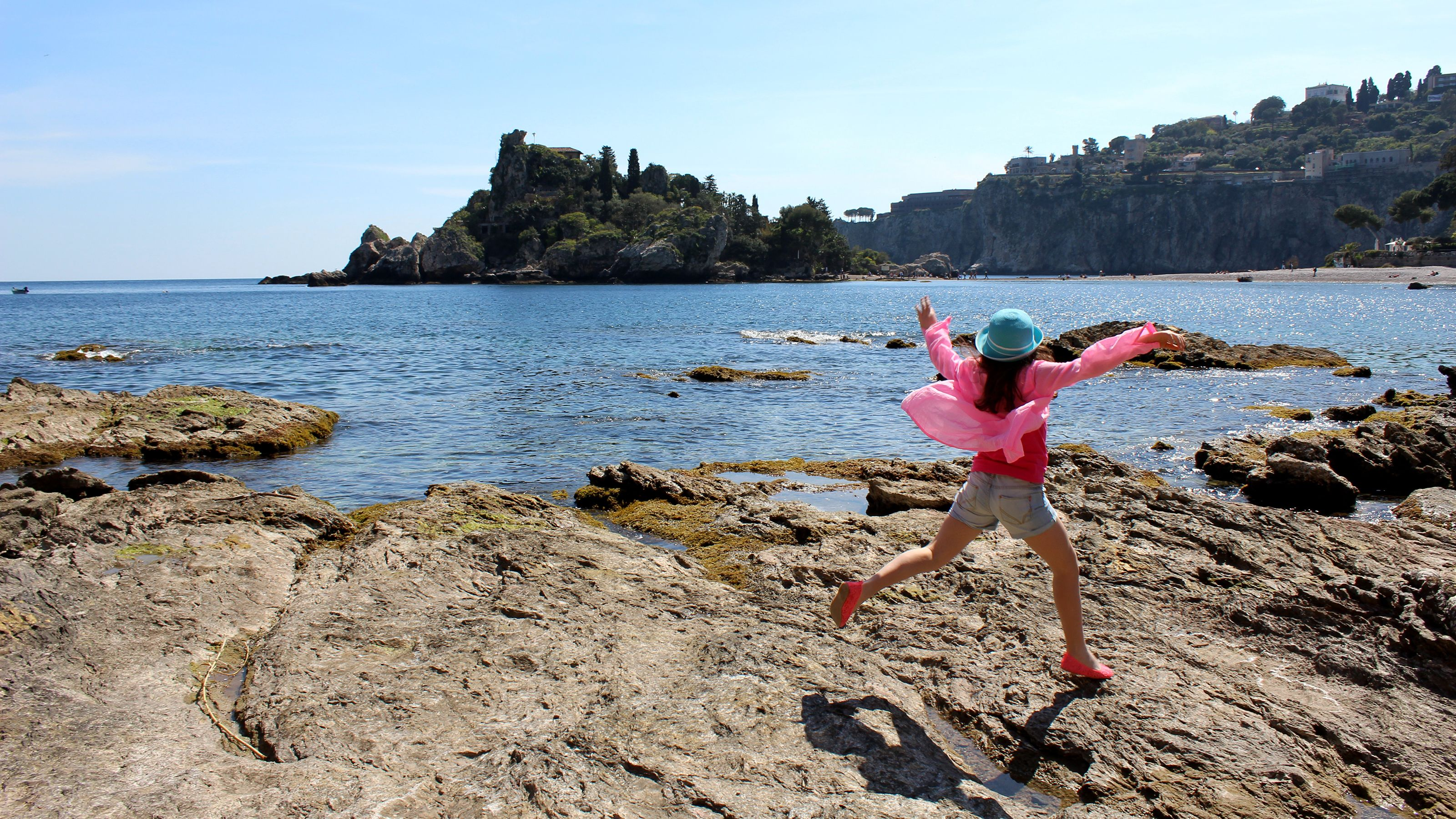 Woman jumps on shore during Taormina Boat Tour