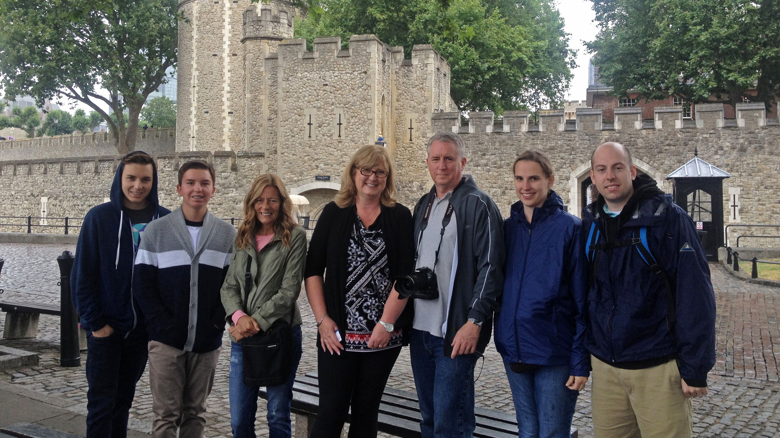 family posing at tower of london