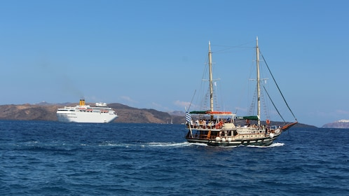 A yacht and a Schooner on the waters around Caldera