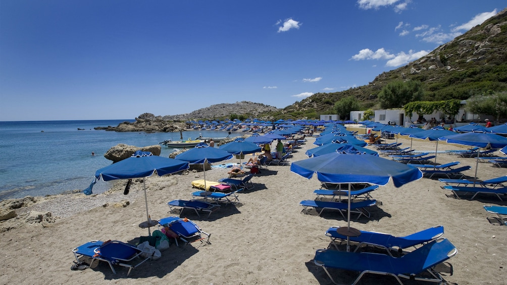 beach with lounge charis and umbrellas
