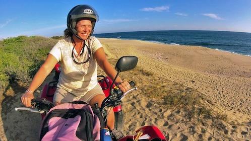ATV rider on beach in mexico