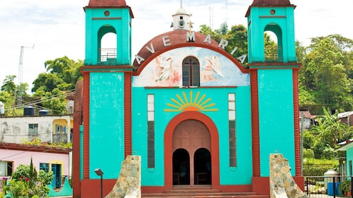 A stucco building called Ave Maria in Mexico