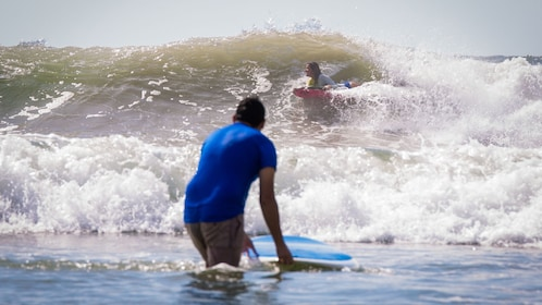 people learning to surf in mexico