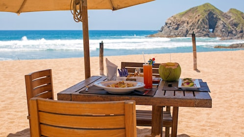 Patio table and chairs on a beach in Mexico