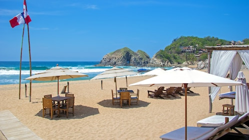 Tables, chairs, and umbrellas on a Mexican beach