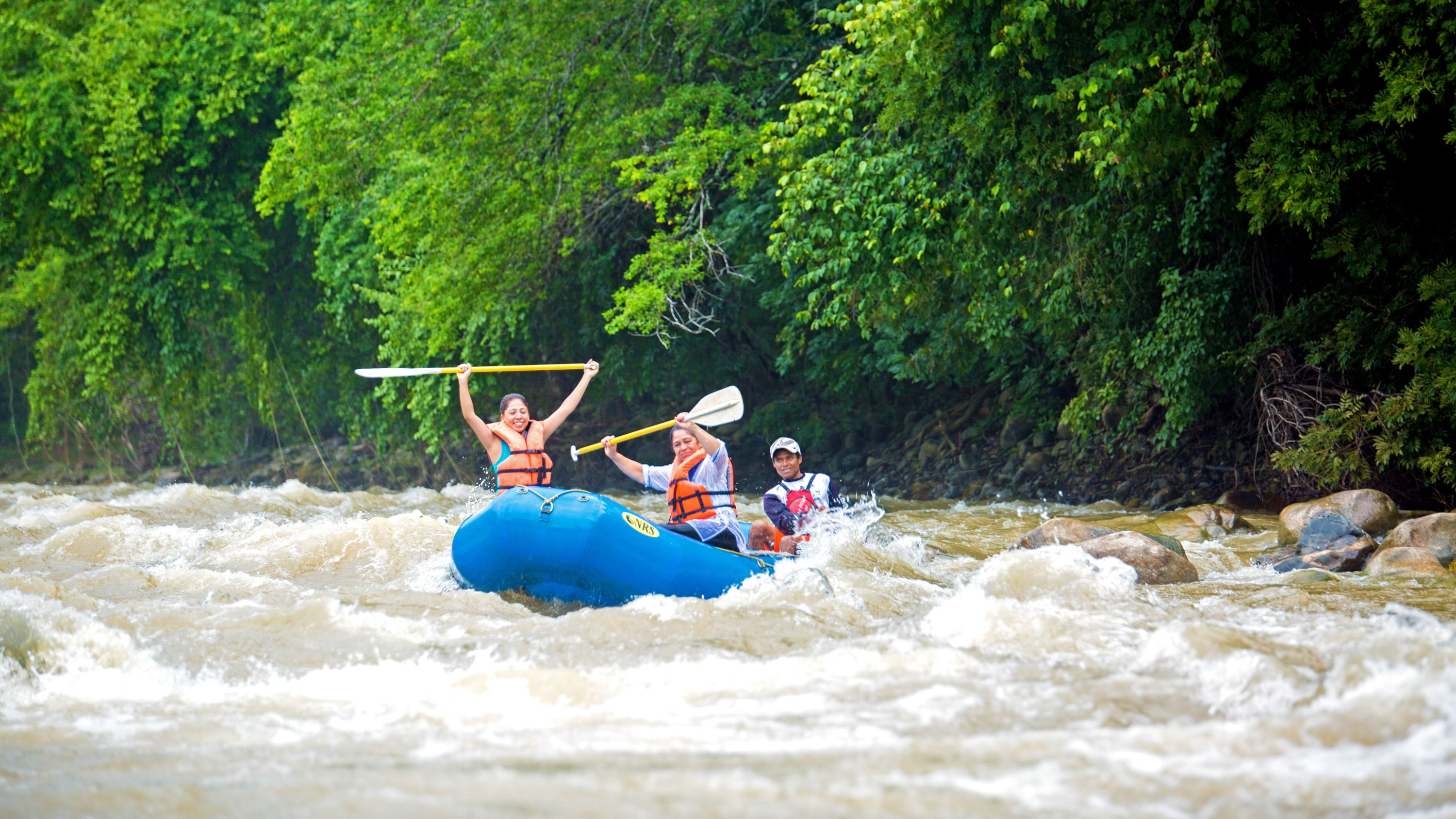 Three rafters ride the rapids on Rio Copalita